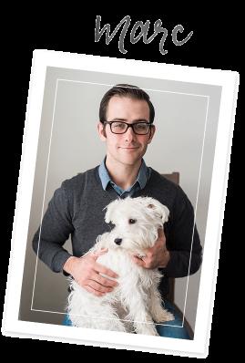 Wedding photographer marc holding puppy